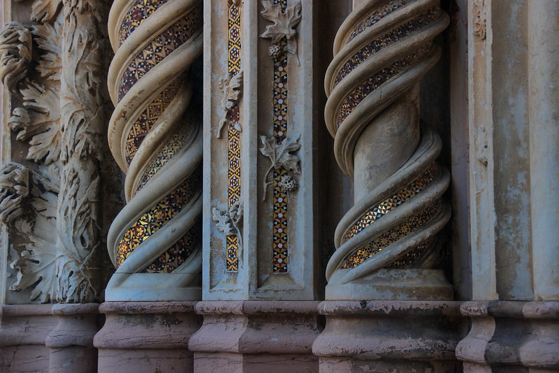 Ground level columns of Orvieto Cathedral show the distresses of being within reach of human traffic. Elevated appointments fare much better.