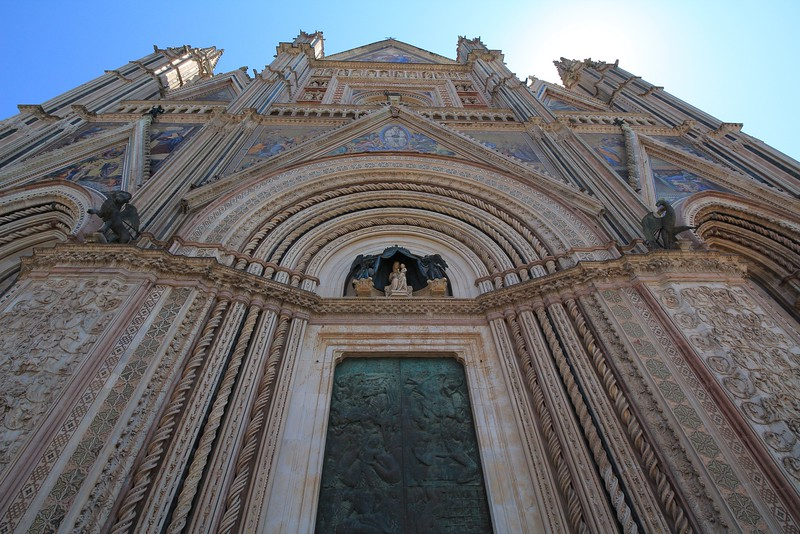Vertical composition of the Orvieto Cathedral. The new bronze door (installed in 1970) did not photograph well in shadow.
