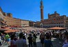 "Piazza del Campo, Siena, Italy, holds a big horse race twice per year and was featured in the James Bond film ""Quantum of Solace""."