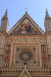 Orcagna's Rose window sits high on Orvieto Cathedral. You need a telescope or binoculars to appreciate the detail up there.