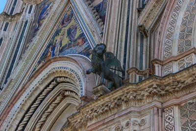 The Orvieto Cathedral facade features many mouldings, accents, and vertical lines, each with a different mosaic color and design. Phenomenal.