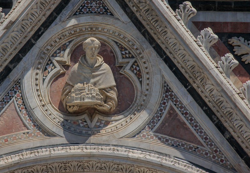 Sculpture on Siena Cathedral, likely deteriorated from full exposure to the elements .