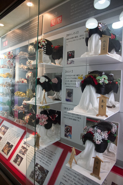 Display of intricate geiko hair styles