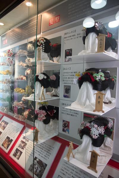 Display of intricate geiko hair styles