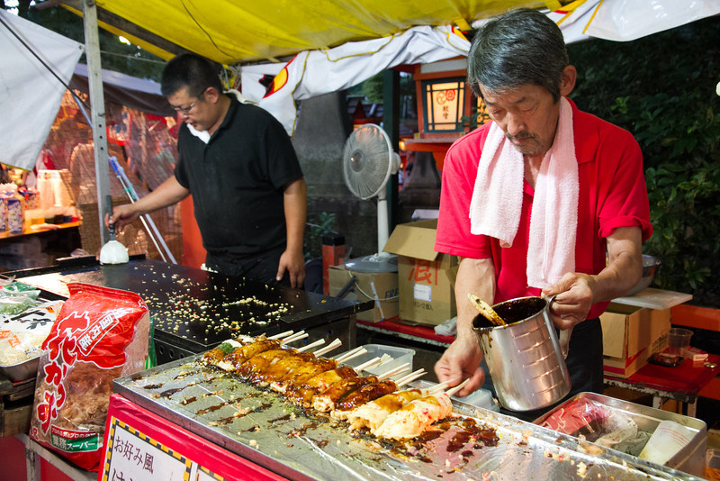 I've never seen this before, but it's okomiyaki on a stick!  Much easier to eat on the go!