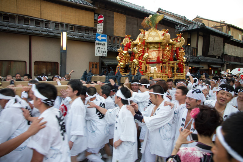 The neighborhood shrine passes through Gion, carried by dedicated festival participants