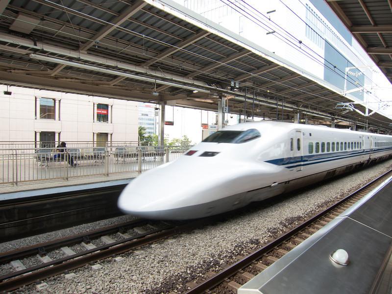 "A shinkansen ""bullet train"" slides into Shin-Yokohama station."