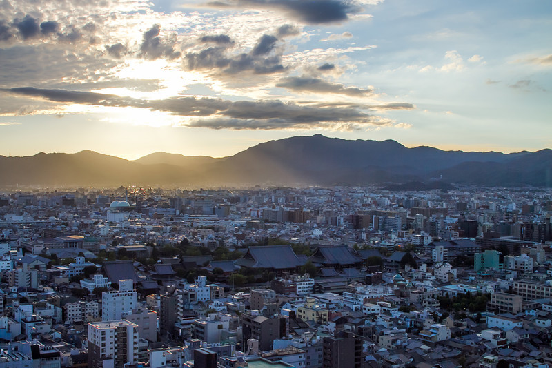The sun begins to set over Kyoto, viewed from Kyoto Tower.