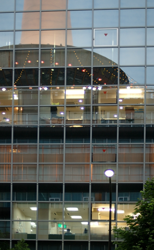 Kyoto tower reflected in office building windows