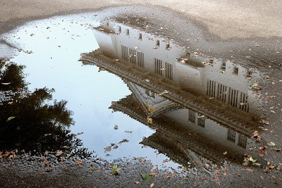 A reflection of the castle in a puddle