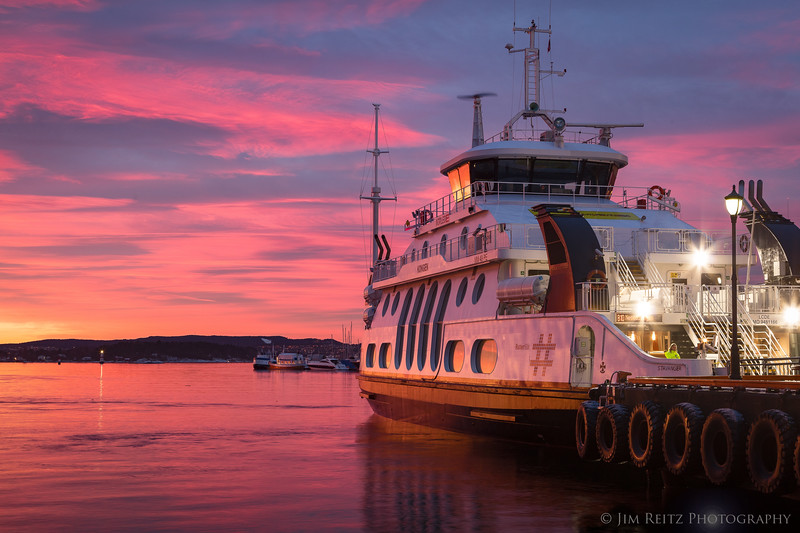 Blazing sunrise clouds at the Oslo, Norway ferry dock.
