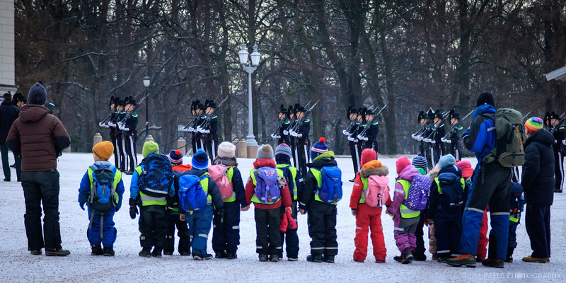 Guards drill at Royal Palace - Oslo, Norway while children watch.