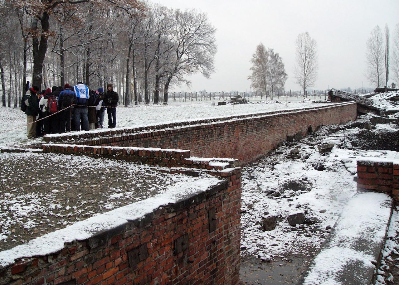 Parents group meets by destroyed crematorium at Auschwitz