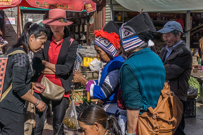 In the market.  The women are traditinal ddress.
