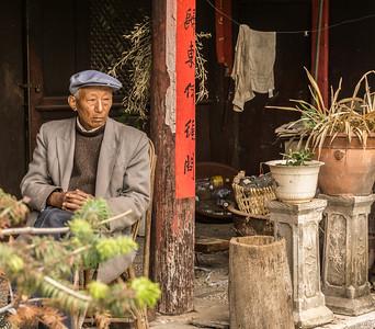 A Nxi man on his porch in Yuhu village.