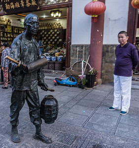 This statue reflecting the old ways is called carrying water