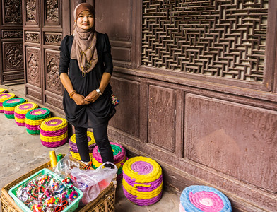 A young woman of the village selling wares for the tourists