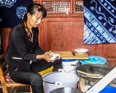 Making some traditional Bai food.