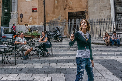 Tourist taking a selfie in front of Church of San Francesco of Assisi