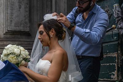 Wedding photographer adjusted the bride's veil