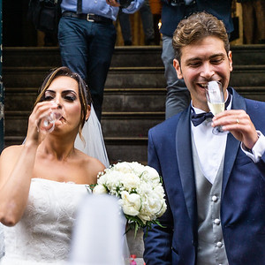 The bride and groom toast thier marriage in Palermo