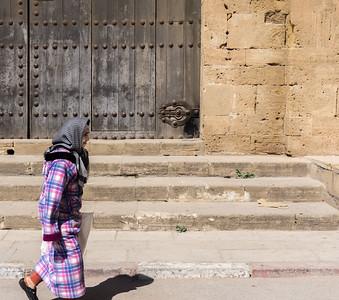 Woman walking outside the kasbah