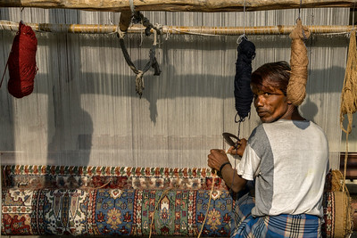 A weaver learning to weave rugs in Jaipur.