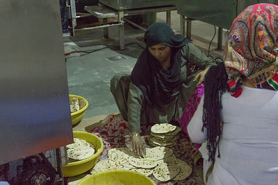 The Langar (food) is prepared by gursikhs who work there and also by volunteers who like to help out. At the Gurdwara, visitors are requested to cover their hair and not to wear shoes.