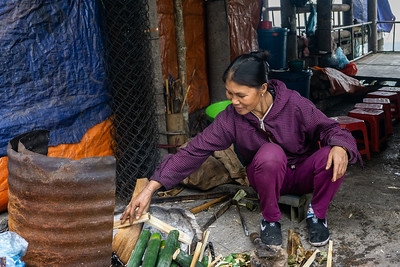 We also stopped at this market.  The woman is preparting sticky rice in banana skins for resale.