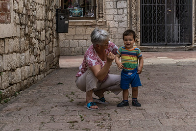 A grandmother and young boy who was fascinated with the American touriss on the streets of Kotor