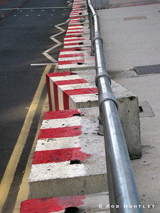 Out of line. Traffic barricade on a downtown street in Leeds, Yorkshire, UK. © Rob Huntley