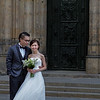 A bride and groom pose in front of Saint Vitus Cathedral