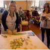Lina making spinach pasta while guide Irena looks on, waiting for the right photo op.