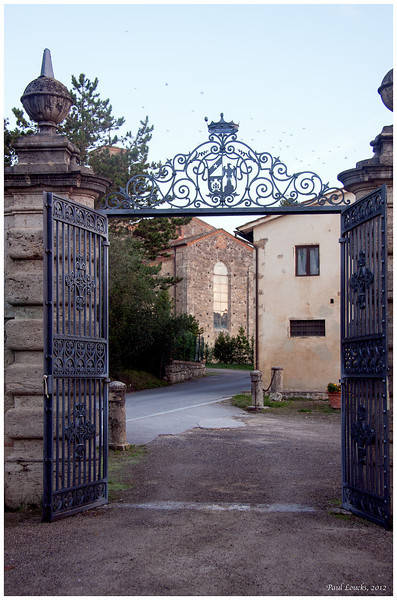 Entrance to the Villa of San Lucchese with an ancient church before the gate.