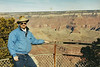 "At the Grand Canyon.  I never really understood the attraction to this place until I saw it for myself.  <br /> <br /> One of the funniest things I saw on the Flintstones cartoons was when they went to see the Grand Canyon.  It was just a little trickle of water.  Barney Rubble said, ""Hmm!  Big deal!""  Fred said, ""Well, of course it doesn't look like much now, but give it a few million years!""  <br /> <br /> Standing on the rim of the Canyon, I started looking at the rim of the far wall and followed it down, down, down,down, down, down until finally seeing the Colorado River WAY, WAY down at the bottom of the Canyon.  Gives one a real impression of just how deep, how wide and how marvelous the Grand Canyon really is. And how many million years it took for that little trickle of water to cut that great big canyon out of Mother Earth."