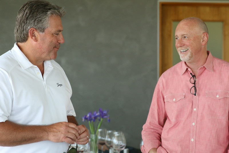 Frank and Bill share a lighter moment after lunch.