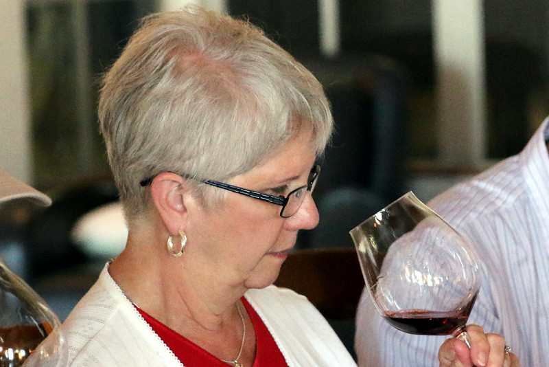 Judy checks the nose of the Dundee Hills Pinot.