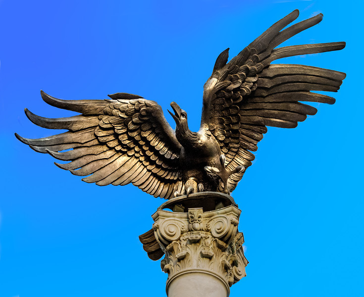 The bronze bird in front of the Federal Reserve Bank of Atlanta building that I took the background out and put a blue sky in it.