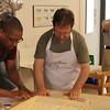 A big hit on our trip was a cooking class. Here I get drawn into rolling Pici. It was great fun followed by great food.