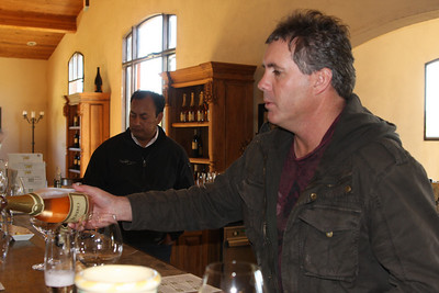 Danny Fetzer pours a Sparkling wine made of 100 percent Pinot Noir. In background, winemaker Cesar Toxqui.
