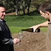 Winemake Chris Nelson pours Riesling near the vineyard which produced the grapes.