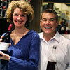 Jill Ditmire with a bottle of Cuvee Eddy and Ron with some barrel sample '09 Sangiovese.