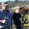 Rusty and 17-year-old Charlie listen to Maria talk to the visiting journalists. Maria is the winemaker and Rusty tends the vineyards.
