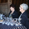 """Maria had children, aunts, and uncles on hand for hospitality. These two aunts were pouring their signature """"Black"""" and """"White"""" wines."""