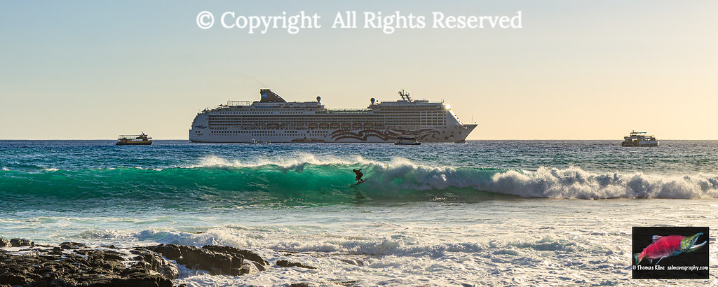 Surfer and cruise ship