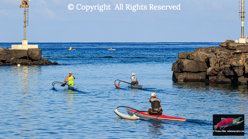 Outrigger canoes heading out