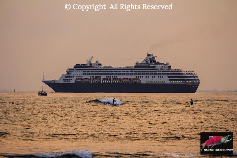 Sunset paddleboarding and the cruiseship M/V Statendam