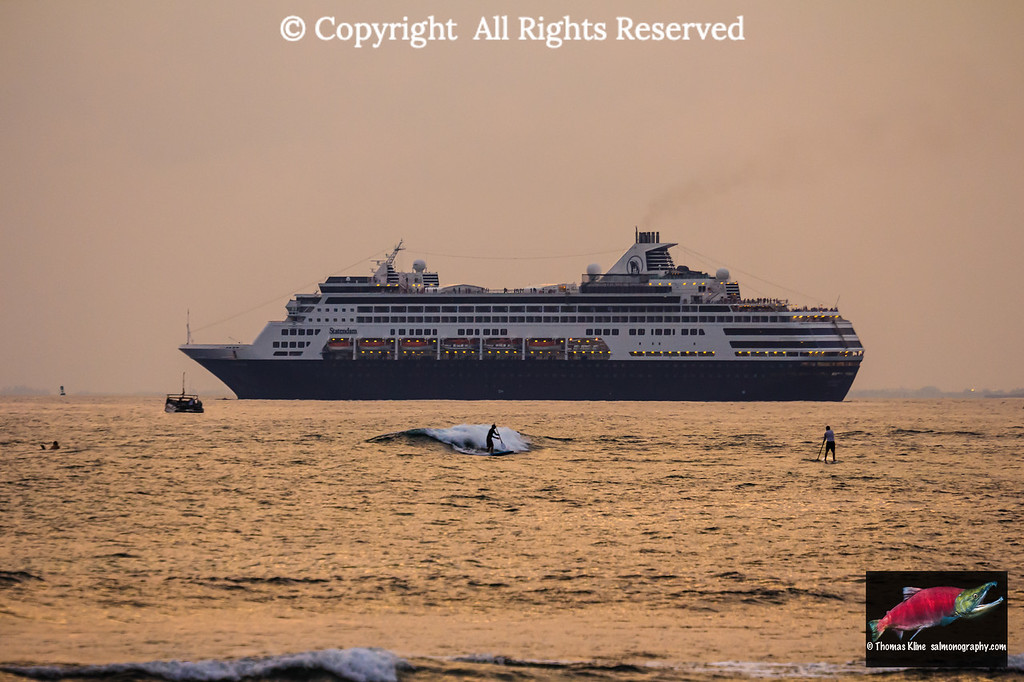 Sunset paddleboarding and the cruiseship M/V Statendam