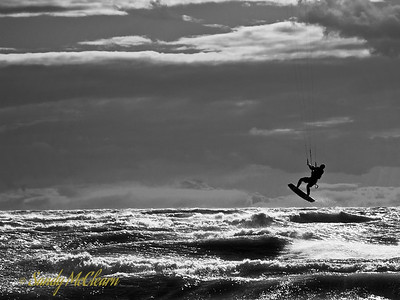 A kite surfer catches some air off the beach at Presqu'ile Provincial Park south of Trenton, Ontario.