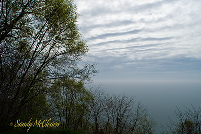 The view from the Scarborough Bluffs out over Lake Ontario on a decidedly grey day.